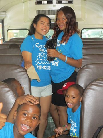 Campus Day Camp Staff and Campers Riding the Bus