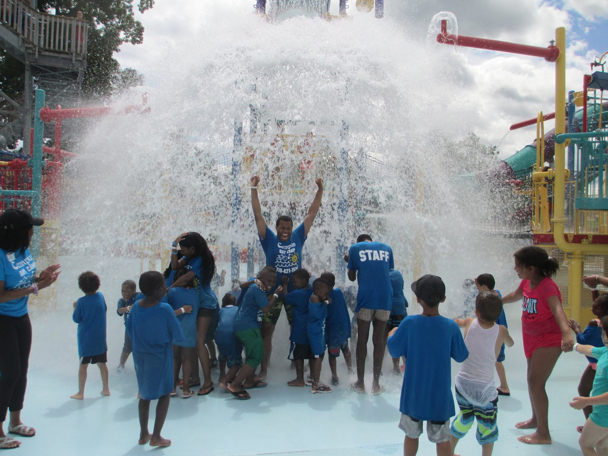 Campus Day Camp Staff and Campers Enjoying the Huge Flood of Water at the Water Park